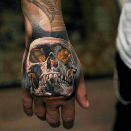 hand tattoos for men - hand tattoos - skull hand tattoo ideas