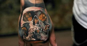 hand tattoos for men - hand tattoos - skull hand tattoo ideas